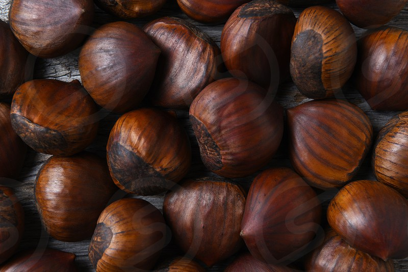 Top view closeup of a group of Chestnuts on a rustic wood table. photo