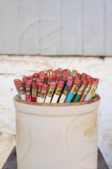 white wooden pencil holder  photo