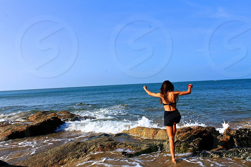 Arms raised inspired woman beach happy joy photo
