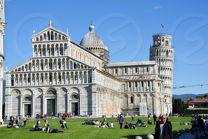 Pisa Cathedral constructed in 1064.  Behind it is the Bell Tower now better known as the Leaning Tower of Pisa built in in the 12th-14th centuries. photo