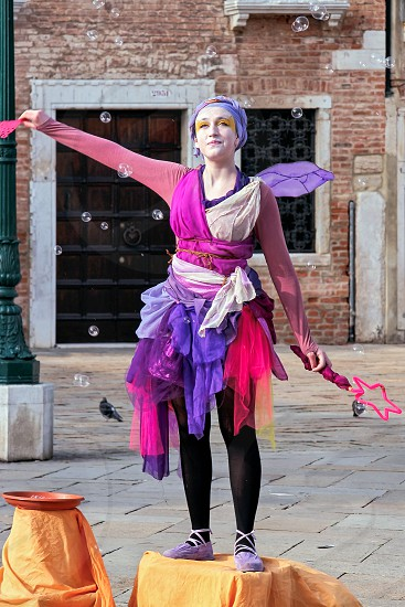 Street Entertainer Creating Bubbles in Venice photo