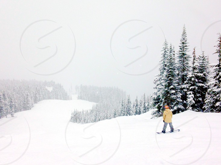 person on snow skiing photography photo