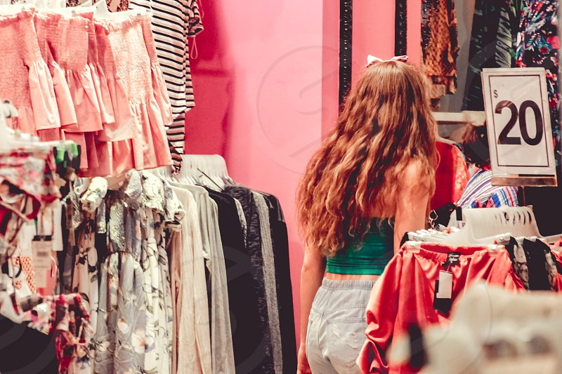 teenage girl shopping for clothes retail fashion clothing photo