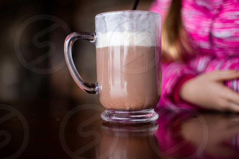 Family enjoying hot chocolate to celebrate Christmas photo