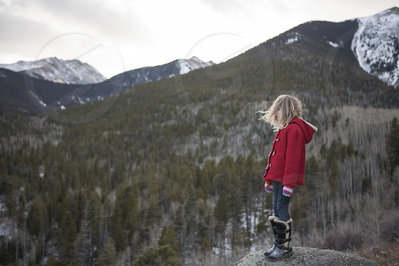 mountains the mountains are calling little girl red coat breathe reflective peace adventure wanderlust explore photo