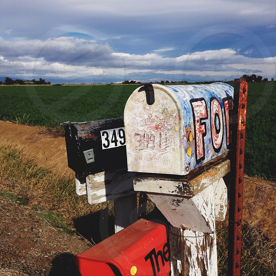 teal white black and red Ford mailbox photo