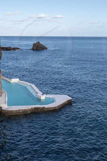 An oceanside salt water pool along the cliffs of Madeira Portugal photo