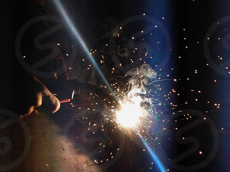 Welding torch at work photo