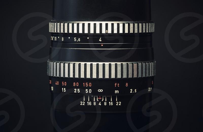 Details of an old vintage manual lens on black background.  photo