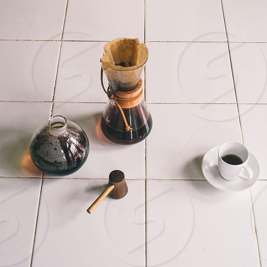 white tea cup on floor photo