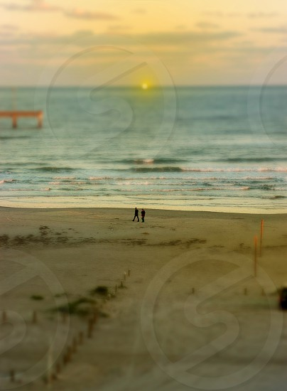 beach couple romantic ocean sand glow nostalgic memories dreamy happy sunset sun light golden sheer drama photo
