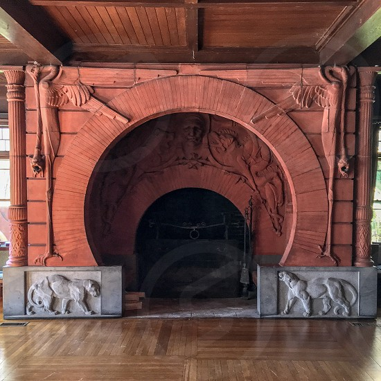 A very old hand crafted stone fireplace  photo