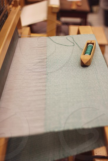 Weaving patterns on a loom.  photo
