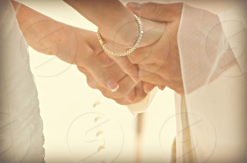 newly married holding hands wedding  photo