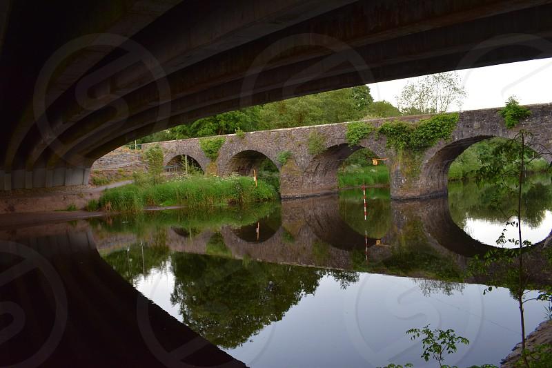 water reflection bridge ireland still water photo