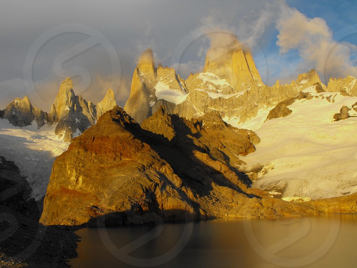 Monte Fitz Roy sun rise before the storm Patagonia Argentina photo