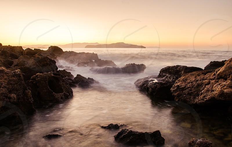 Sunset beach Chania Crete island photo