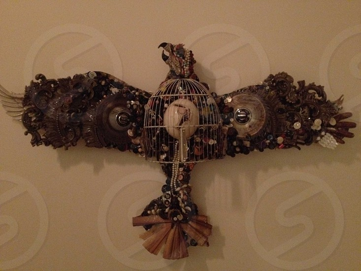 brown wooden eagle wall ornament photo