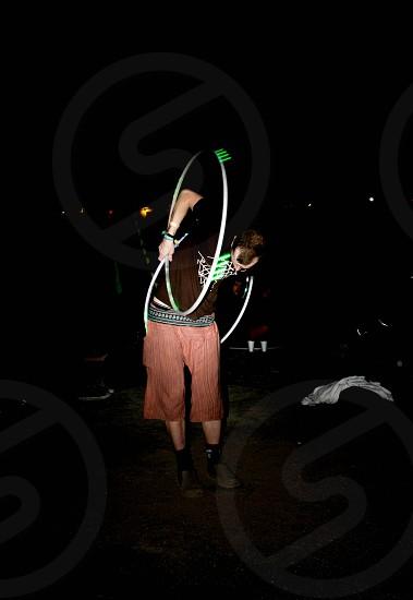 Guy hula hooping photo