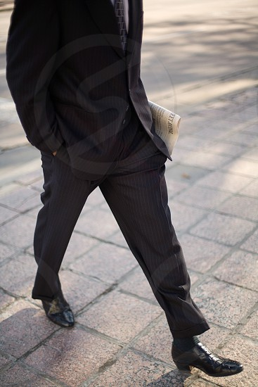 bussinesman walking with newspaper photo
