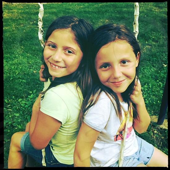 Friendship bond girlfriends smile swing together happy photo