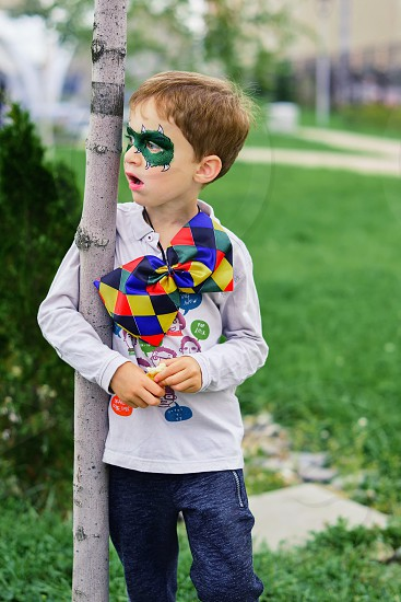 Add keywords separated by comma or semi-Colonel face painting photo