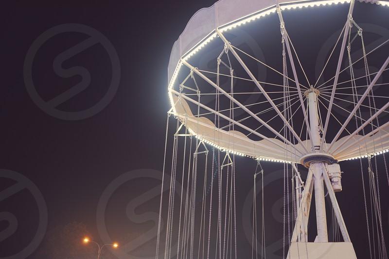 Floodlit White Chain Merry-go-round at Night Closeup photo