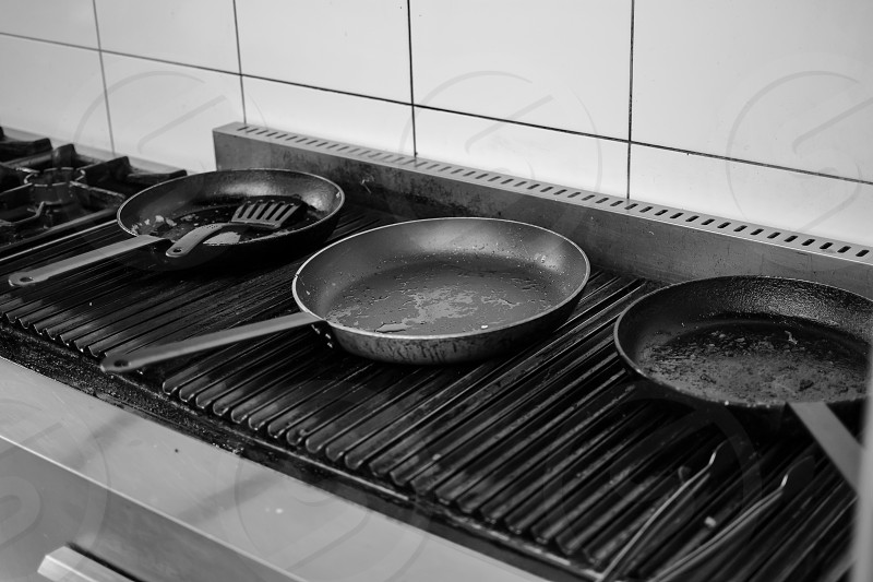 Frying pan on a cooker. Black and white photo. photo