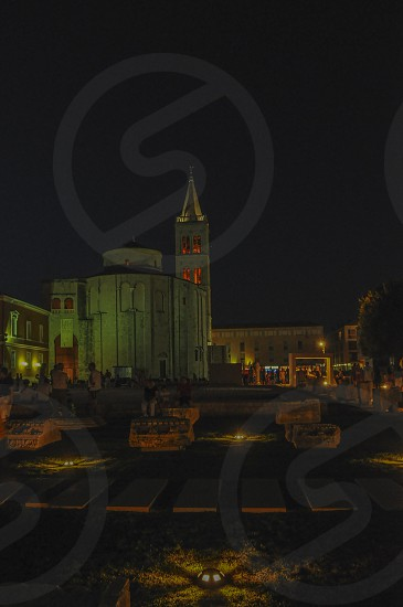Zadar cathedral at night with archeological park in front. photo