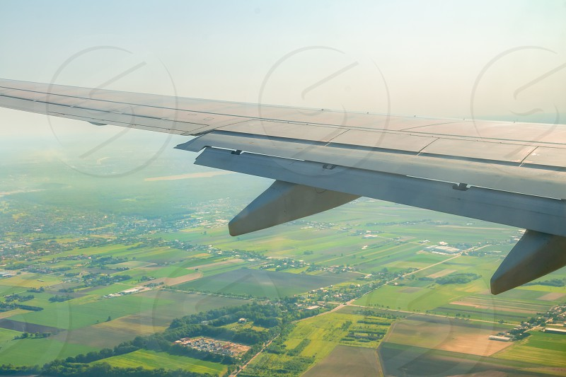 Airplane wing during landing with flaps down. photo