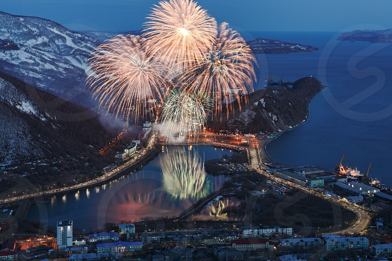 "PETROPAVLOVSK-KAMCHATSKY KAMCHATKA RUSSIA - MAY 9 2014: Fireworks celebration ""Victory Day"" in the Great Patriotic War ""May 9"". Salute over Petropavlovsk-Kamchatsky Avacha Bay and Pacific Ocean. photo"