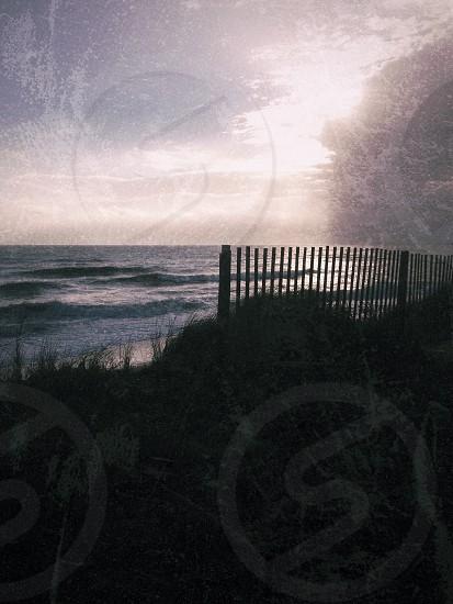 grey fence near shoreline photo