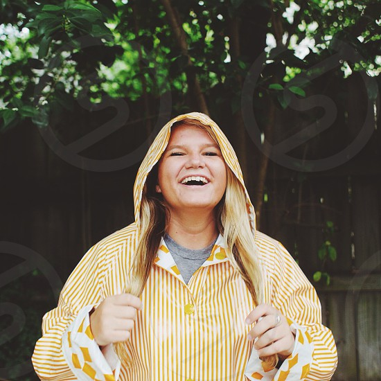 woman smiling in yellow and white striped hoodie photo