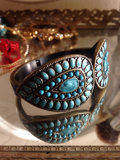 brown ring with teal gemstone photo