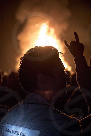 Burning man bonfire rock and roll rebel silhouette rad self expression burn your fire photo