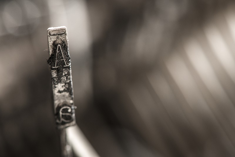 Plate letter A on a typewriter. Close up photo