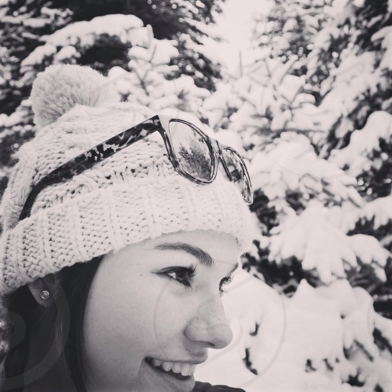 woman with beanie grayscale photo