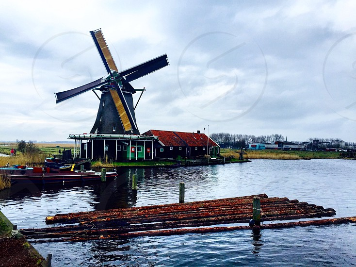 Holland Netherlands travel countryside Dutch windmill water lumber explore visit experience photo