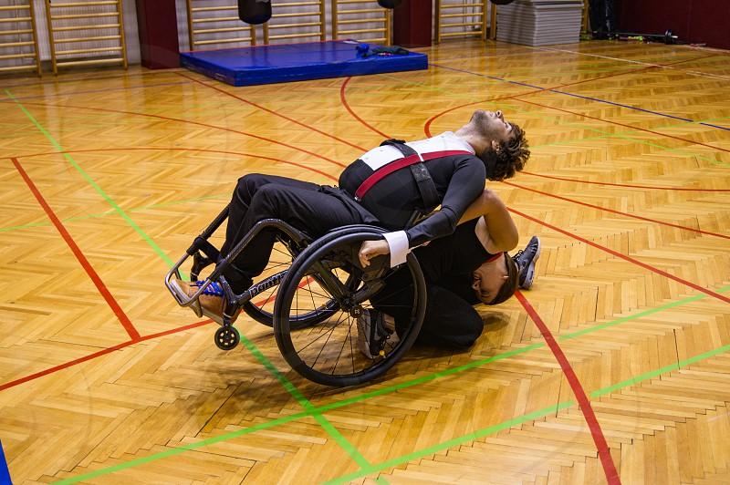 Para dancing couple practicing their choreography. Wheelchair dance sport. photo