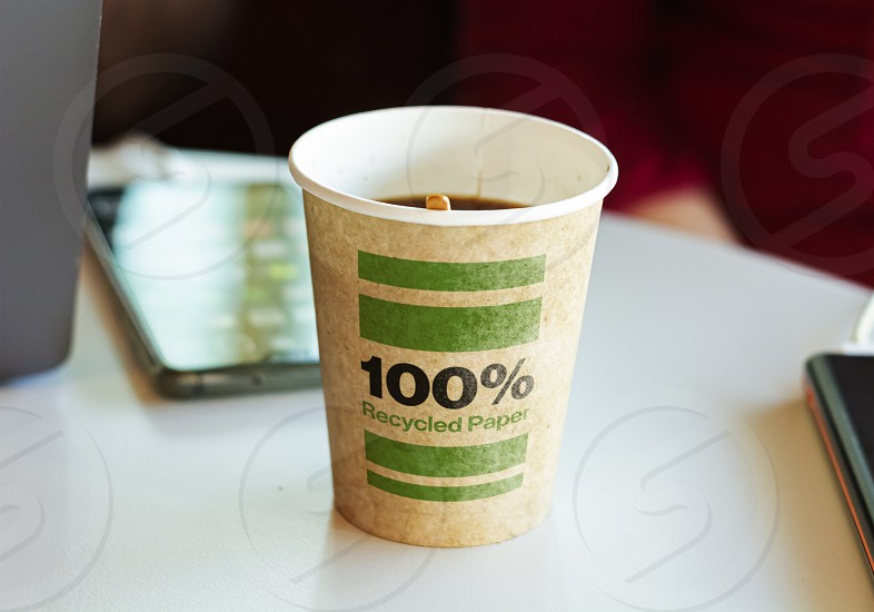a recycled paper container containing hot coffee for a break. Environmental protection and ecological issues photo