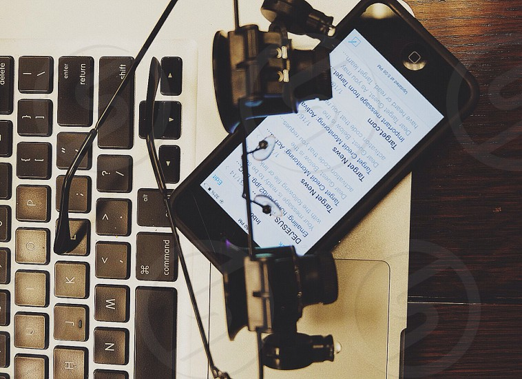 black iphone on white laptop photo