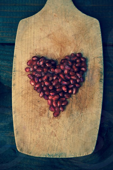 Pomegranate Seed Heart on Cutting Board photo