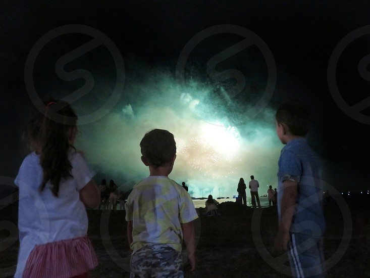 toddlers staring at summer fireworks photo
