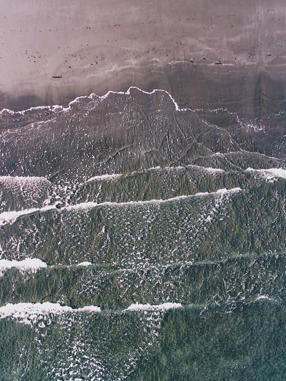 ocean wave crushing on seashore during daytime photo