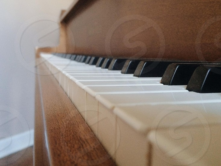 brown wooden piano  photo