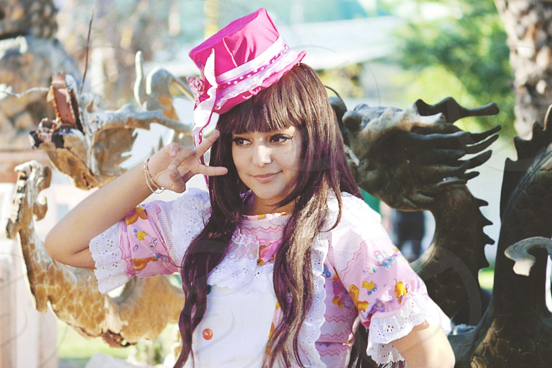 kawaii anime convention japanese asian dragon peace lolita cute girl woman long hair pink hat dress fashion style photo