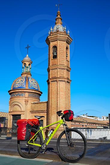 Via de la plata bike at Isabel II bridge Capilla del Carmen in Triana Seville Andalusia Spain photo