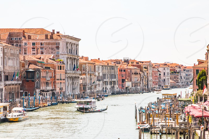 Gondola Rides At Grand Canal In Venice Italy photo