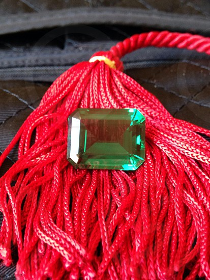 Emerald on red strings photo