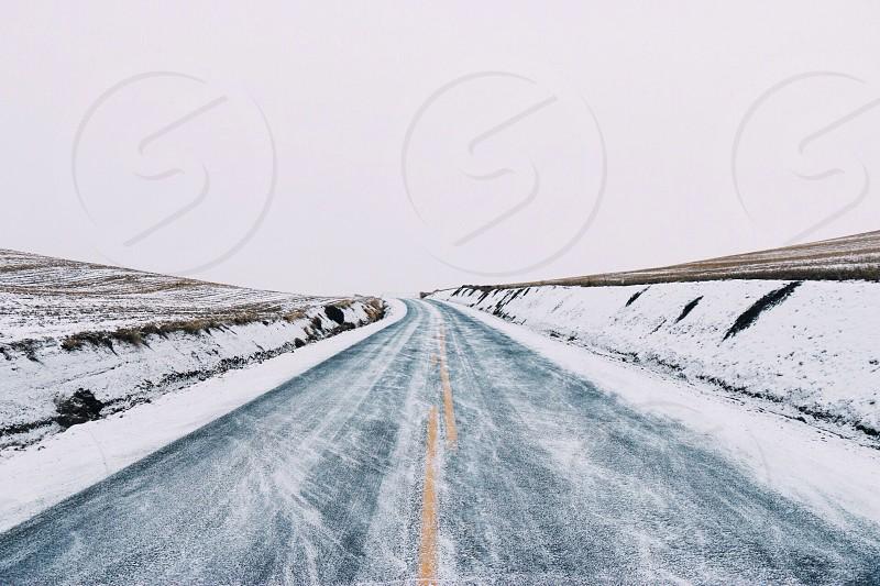 frozen road next to fields photo
